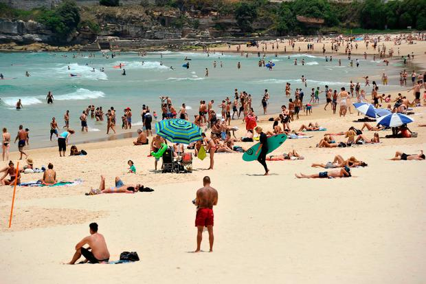 People gather on the sand at Bondi Beach in Sydney, Australia. (Photo: AAP Image via AP)