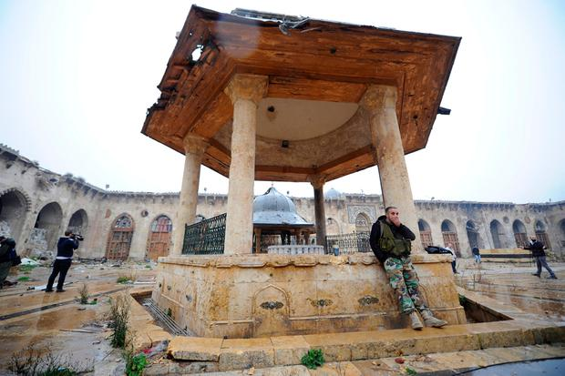 Forces loyal to Syria's President Bashar al-Assad stand inside the Umayyad mosque, in the government-controlled area of Aleppo, during a media tour, Syria December 13, 2016. REUTERS/Omar Sanadiki