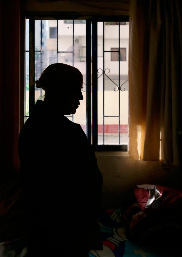 Syrian refugee Hiam, 48, who has terminal cancer, lives in a small one-room apartment in Tripoli with her two daughters after fleeing from Edleb in Syria. (Photo: PA)
