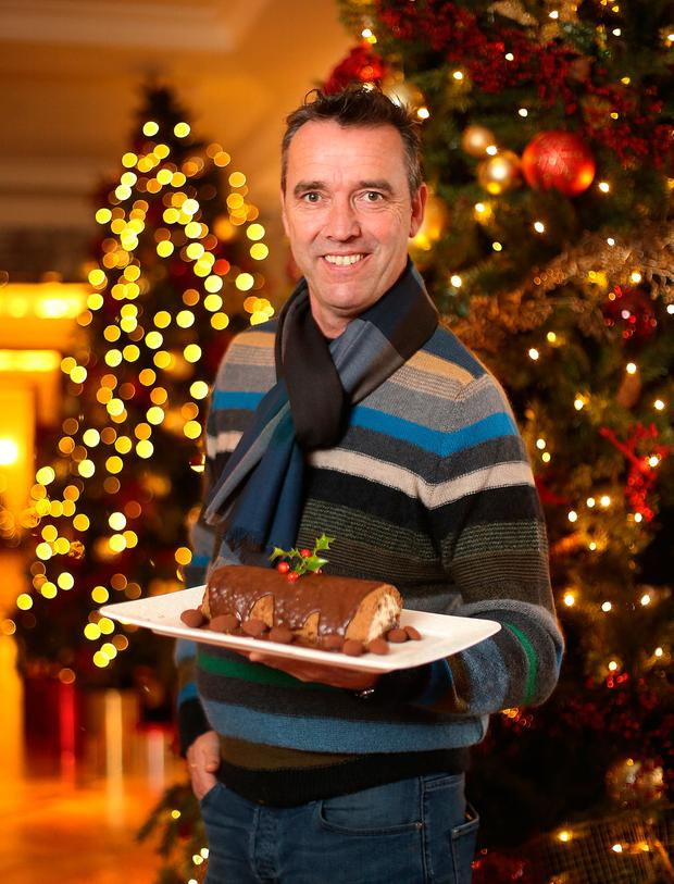 Chef Kevin Dundon with his chocolate roulade log. Kevin's jumper and shirt by Paul Smith of Brown Thomas. Photo: Frank Mc Grath