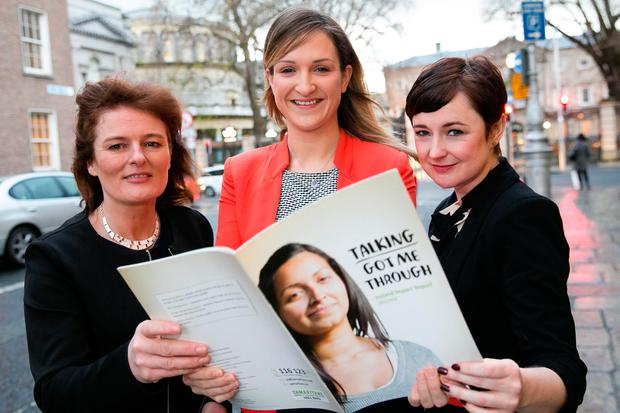 Deirdre Toner, Executive Director of Samaritans Ireland, Helen McEntee TD, and Professor Siobhan O'Neill, University of Ulster with the charity's Impact Report. Samaritans Ireland receives most calls from 6pm to midnight. Photo: Orla Murray