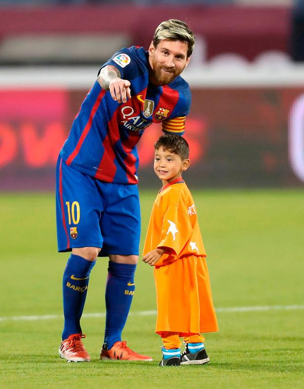 Barcelona's Lionel Messi meeting Murtaza Ahmadi in Doha on Tuesday. Photo: Karim Jaafar/AFP/Getty Images