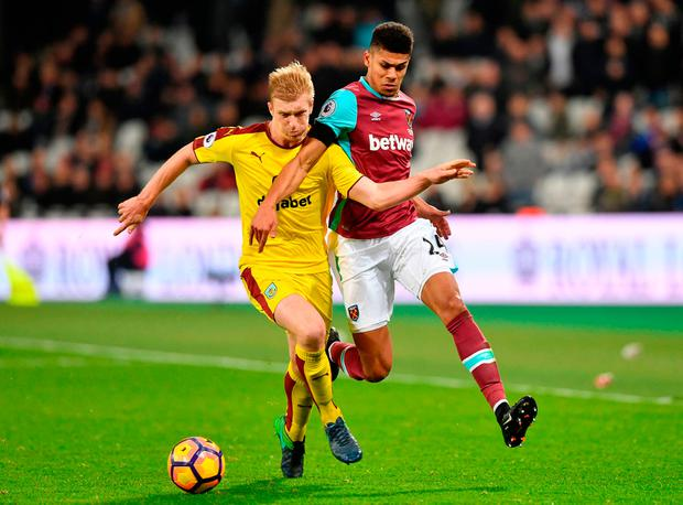 Burnley's Ben Mee (left) and West Ham United's Ashley Fletcher (right) battle for the ball Picture: PA