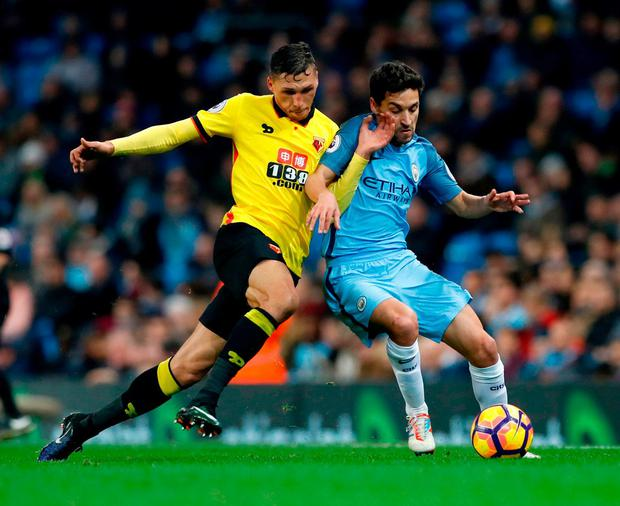 Watford's Jose Holebas (left) and Manchester City's Jesus Navas battle for the ball. Photo: Martin Rickett/PA Wire.