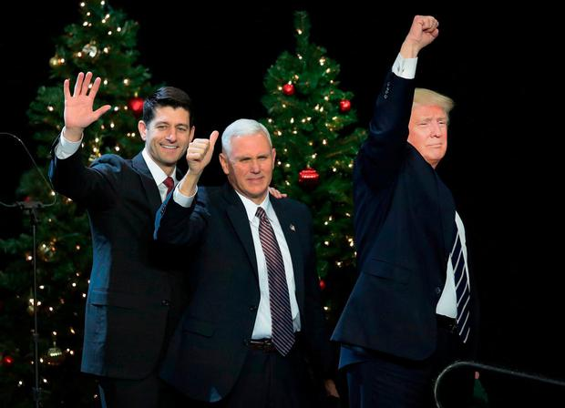 President-elect Donald Trump at a Thank You Tour 2016 rally along with Paul Ryan (left), speaker of the US House of Representatives, and Vice President-elect Mike Pence (centre). Trump has been visiting states across the country since he won the election, before officially taking office on January 20. Photo: Scott Olson/Getty Images