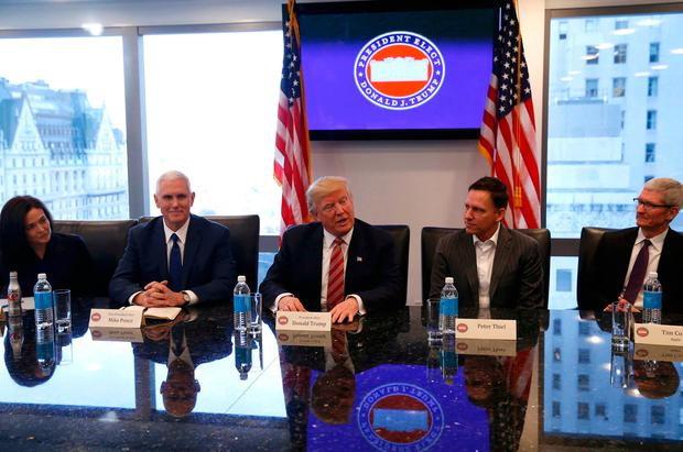 Donald Trump sits with Vice President-elect Mike Pence PayPal co-founder Peter Thiel, Apple's Tim Cook and Facebook' Sheryl Sandberg during a meeting with technology leaders at Trump Tower