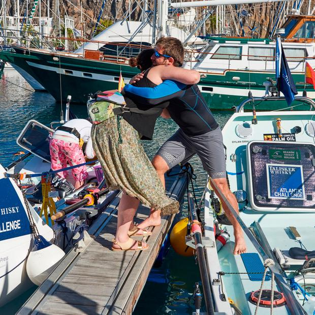 Gavan Hennigan hugging his sister before setting off in the Talisker Whisky Atlantic Challenge, known as the world's toughest row, from La Gomera, a small island in the Canary Islands. Ben Duffy/PA Wire