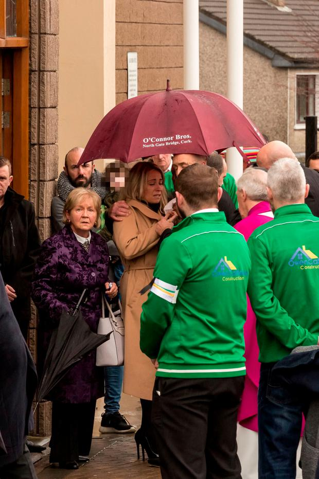 Fiancee, Marion Ryan mourns as the body of Aidan O'Driscoll who was shot to death in Blackpool, Cork City last week, is removed form St Olivers Church, Dublin Hill to be taken to nearby St Catherines Cemetry, Kilcully for burial.