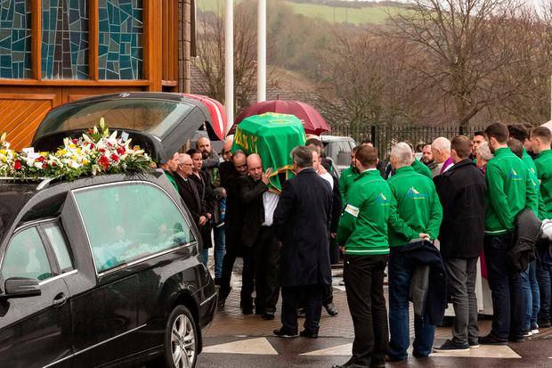 The body of Aidan O'Driscoll who was shot to death in Blackpool, Cork City last week, is removed form St Olivers Church, Dublin Hill, in the driving rain, to be taken to nearby St Catherines Cemetry, Kilcully for burial.