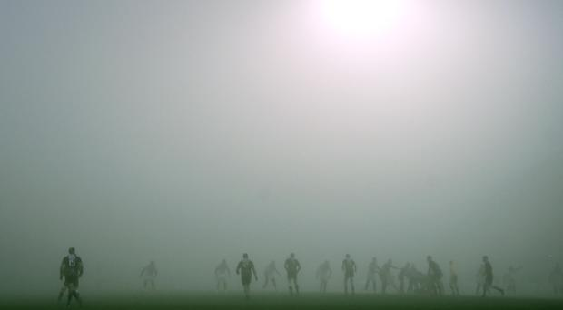 Players run in the fog during the European Rugby Champions Cup Pool 2, round 3 match Zebre Rugby vs Stade Toulousain at the Lanfranchi Stadium in Parma. AFP/Getty Images