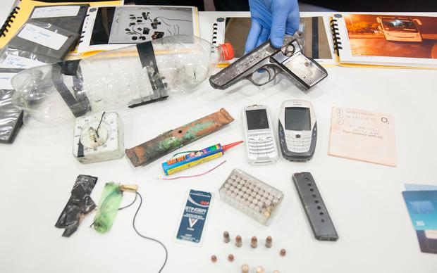 Gardaí show off items seized in the Donal Billings case, including a gun with bullets, two phones and a homemade bomb. Photo: Gareth Chaney Collins