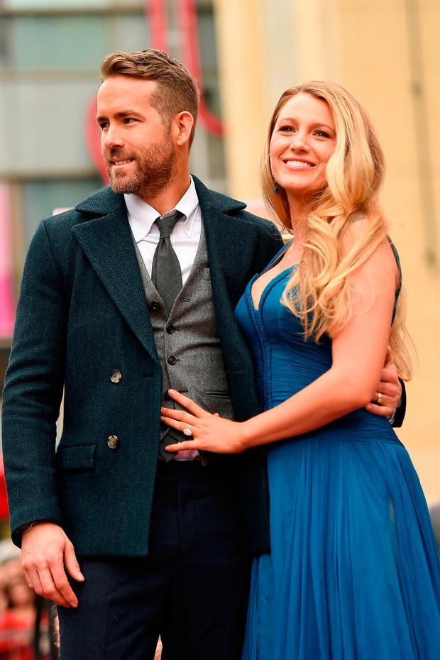 Actors Ryan Reynolds (L) and Blake Lively pose for a photo as Ryan Reynolds is honored with star on the Hollywood Walk of Fame on December 15, 2016 in Hollywood, California. (Photo by Matt Winkelmeyer/Getty Images)