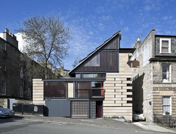 The exterior of a property with a hidden bath and disappearing walls which has been named house of the year Keith Hunter/RIBA/PA Wire