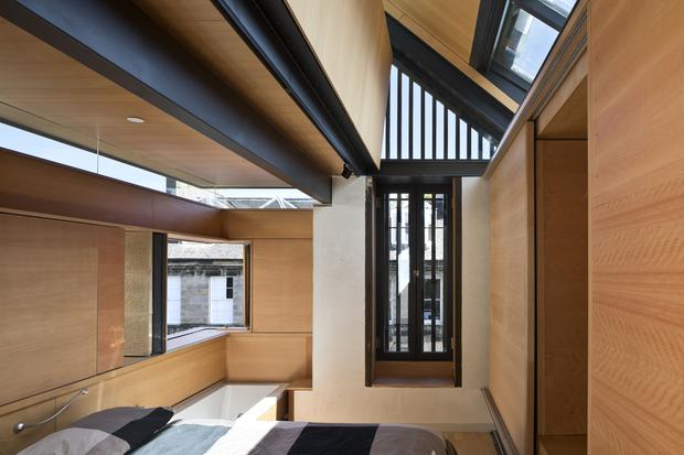 The interior of a property with a hidden bath and disappearing walls which has been named house of the year Keith Hunter/RIBA/PA Wire
