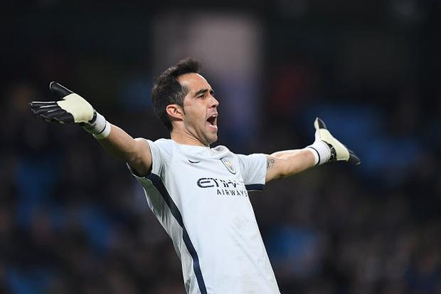 Manchester City's Chilean goalkeeper Claudio Bravo reacts during the English Premier League football match between Manchester City and Watford at the Etihad Stadium in Manchester, north west England, on December 14, 2016. / AFP / Anthony DEVLIN / RESTRICTED TO EDITORIAL USE.