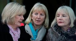 Bernadette Scully (centre) with sister Teresa (left) leaving the Central Criminal Court, where she was found not guilty of the manslaughter of her daughter. Photo: Collins Courts