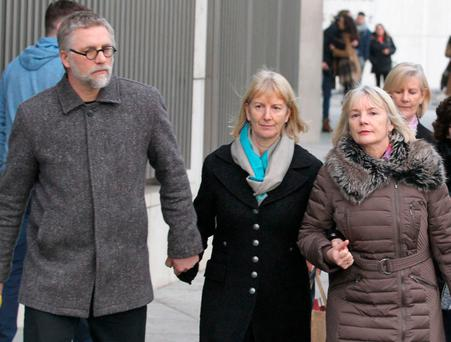 Bernadette Scully with her partner, Andrius Kozlovskis pictured leaving the Central Criminal Court in Dublin. Photo: Collins Courts