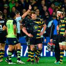 Northampton Saints' Dylan Hartley is shown a red card by referee Jerome Garces during the game against Leinster. Photo credit: Joe Giddens/PA Wire