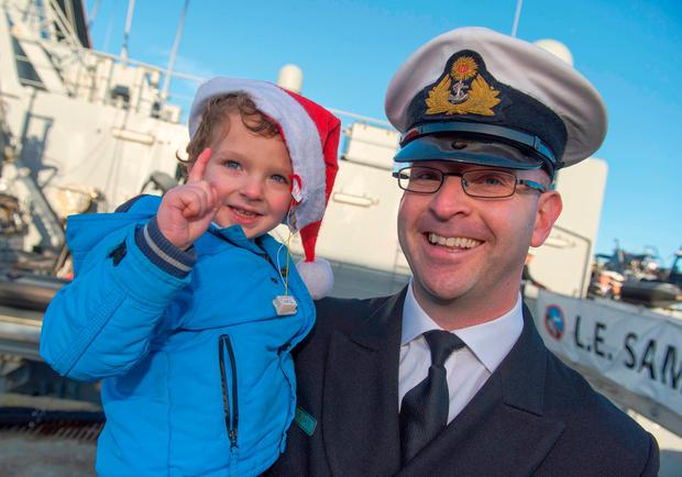 Lt Commander Darragh Kirwan is greeted by his son Sean at the quayside. Photo: Michael Mac Sweeney/Provision