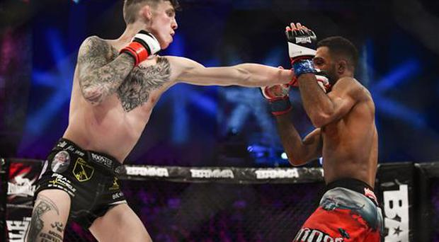 16 December 2016; Rhys McKee, left, in action against Jai Herbert during their Lonsdale Lightweight Title bout at BAMMA 27 in the 3 Arena in Dublin. Photo by Ramsey Cardy/Sportsfile