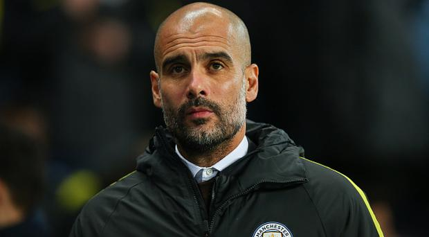 MANCHESTER, ENGLAND - DECEMBER 14: Josep Guardiola manager / head coach of Manchester City during the Premier League match between Manchester City and Watford at Etihad Stadium on December 14, 2016 in Manchester, England. (Photo by Robbie Jay Barratt - AMA/Getty Images)