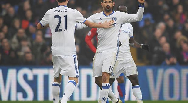 LONDON, ENGLAND - DECEMBER 17: Diego Costa of Chelsea (R) celebrates scoring his sides first goal with Nemanja Matic of Chelsea (L) during the Premier League match between Crystal Palace and Chelsea at Selhurst Park on December 17, 2016 in London, England. (Photo by Darren Walsh/Chelsea FC via Getty Images)