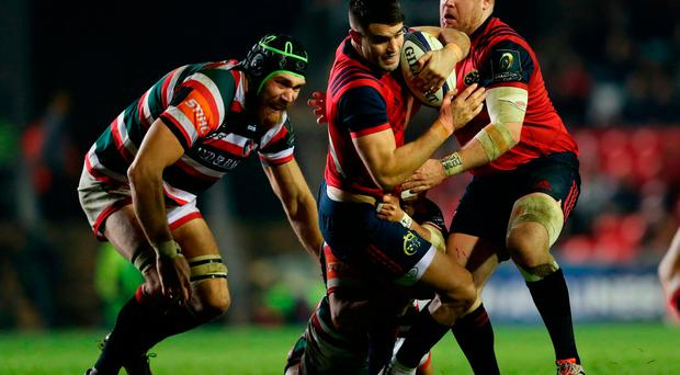 Munster's Conor Murray is tackled by Leicester Tigers Lachlan McCaffrey
