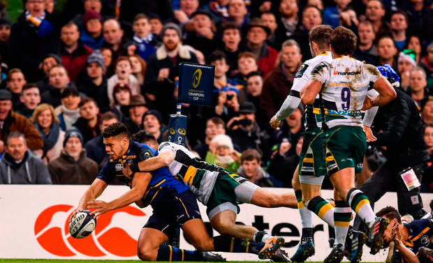 Adam Byrne of Leinster goes over to score his side's first try