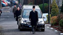 FAREWELL: The funeral hearse arriving at Mount Jerome. Photo: Steve Humphreys