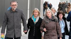 MOTHER: Bernadette Scully outside court with her partner Andrius Kozlovskis (left). Photo: Collins