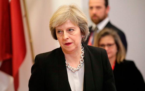 Prime Minister Theresa May has pledged to cut her country's corporation tax rate. Photo: AP
