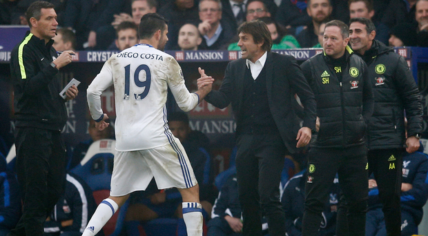 Diego Costa celebrates Chelsea's goal with manager Antonio Conte at Selhurst Park yesterday. Photo Reuters