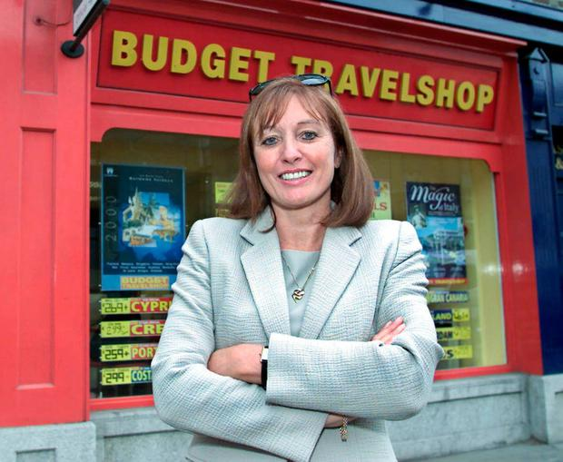 Gillian Bowler running her successful Budget Travel business. Photo: Colin Keegan
