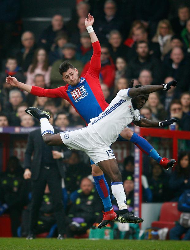 Crystal Palace's Joel Ward and Chelsea's Victor Moses in full flight. Photo: Reuters