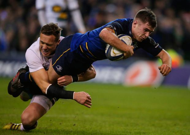 Leinster's Luke McGrath scores a try. Photo: PA