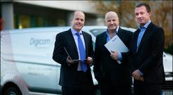 Sean Gallagher with Digicom's Greg Clarke and Peter Fox. Photo: David Conachy