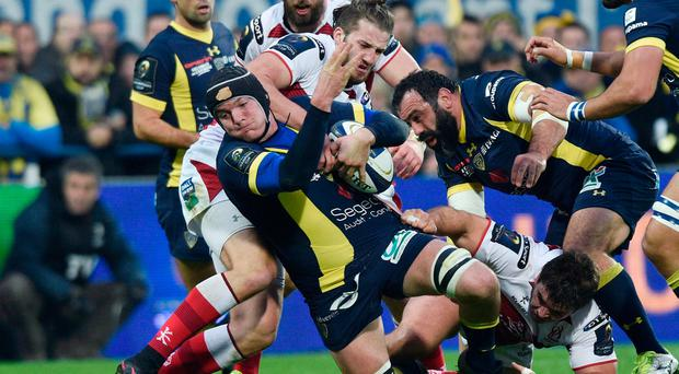 Clermont's French lock Arthur Iturria (L) is tackled