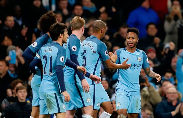 Sterling celebrates scoring their second goal with team mates
