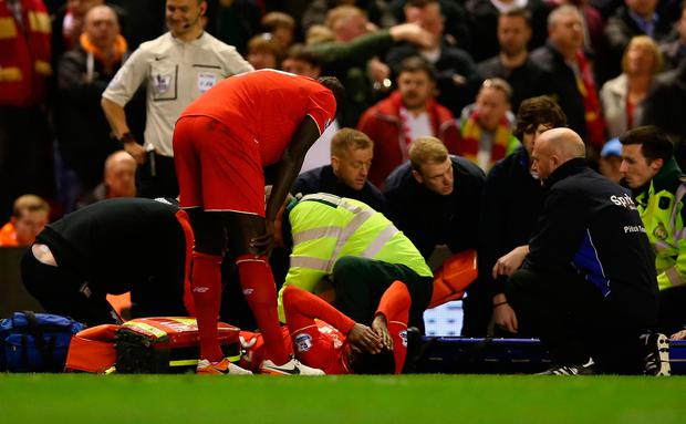 Divock Origi lies injured during a Merseyside derby victory for Liverpool last season. Photo: Clive Brunskill/Getty Images