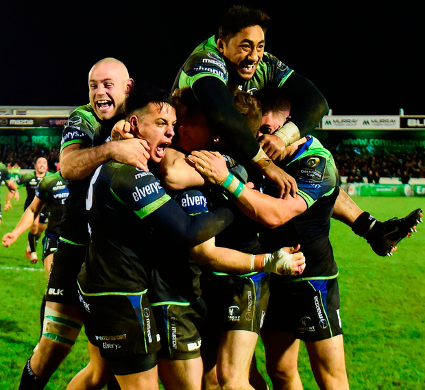 Jack Carty is swamped by his Connacht team-mates after kicking the match-winning conversion against Wasps. Photo: Matt Browne/Sportsfile