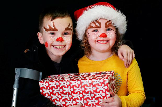 Brother and sister Adam (8) and Rebecca (6) Freer, from Tallaght, in Dublin, at the party. Photo: Steve Humphreys