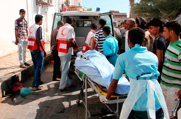 Doctors transport the body of one of the victims to a hospital in Aden following the suicide bomb. Photo: Getty Images