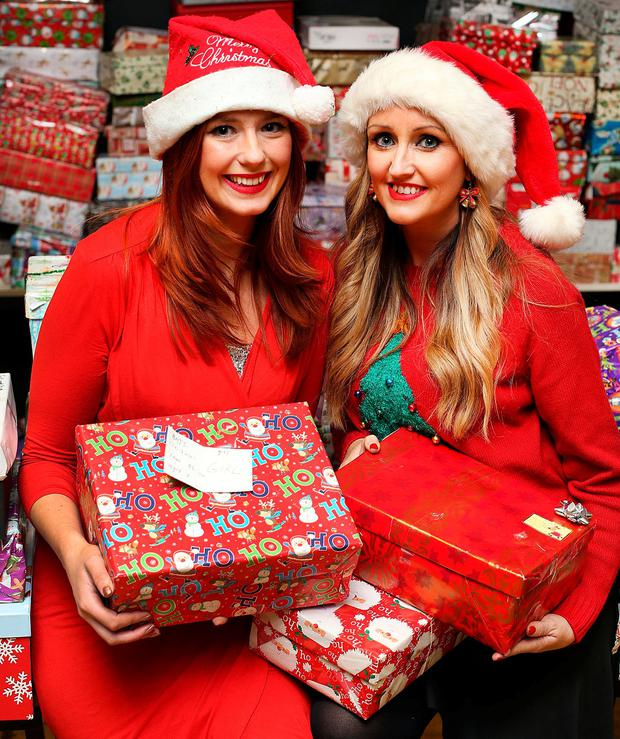 Volunteer sisters Katie Byrne from Templeogue and Krista from Lucan at the Irish Housing Network Christmas party supported by Inner City Helping Homeless at Ayrfield Communit y Centre in Coolock in Dublin. Photo: Steve Humphreys