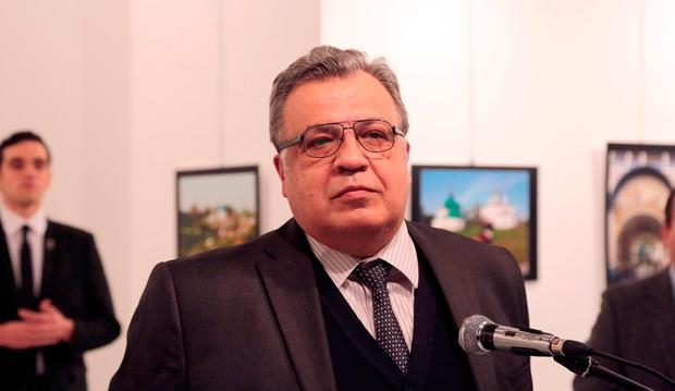 The Russian Ambassador to Turkey Andrei Karlov speaks a gallery in Ankara Monday Dec. 19, 2016. (AP Photo/Burhan Ozbilici)
