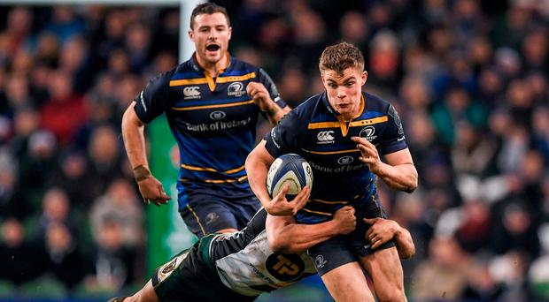 Leinster outside centre Garry Ringrose is tackled by Nic Groom of Northampton as Robbie Henshaw rushes to support him at the Aviva on Saturday night. Photo: Brendan Moran/Sportsfile