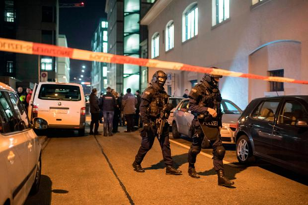 Special Unit Policemen secure the area in front of the Islamic center, in Zurich, Monday, Dec. 19, 2016. (Ennio Leanza/Keystone via AP)