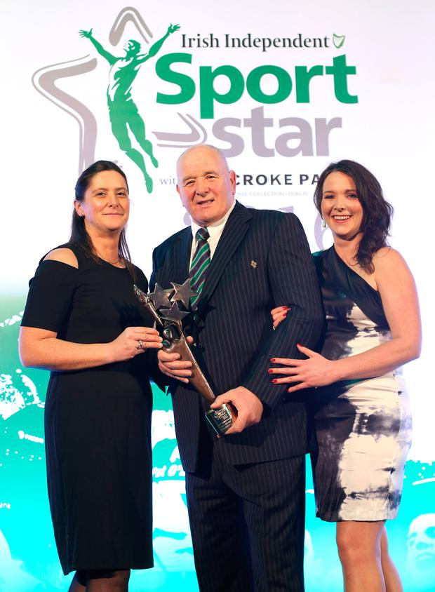 Brendan Foley, father of Anthony Foley pictured with his daughters Rose and Orla, as they accept the Hall of Fame Award on Anthony's behalf, at the Irish Independent Sport Star of the Year Awards. Photo: Frank McGrath