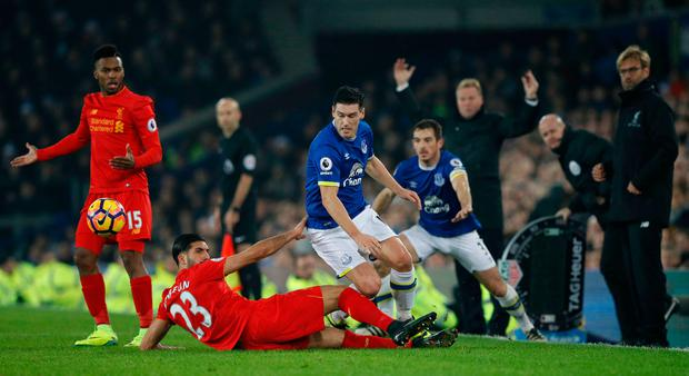 Britain Football Soccer - Everton v Liverpool - Premier League - Goodison Park - 19/12/16 Liverpool's Emre Can and Daniel Sturridge in action with Everton's Gareth Barry as Everton manager Ronald Koeman and Liverpool manager Juergen Klopp react Reuters / Phil Noble Livepic