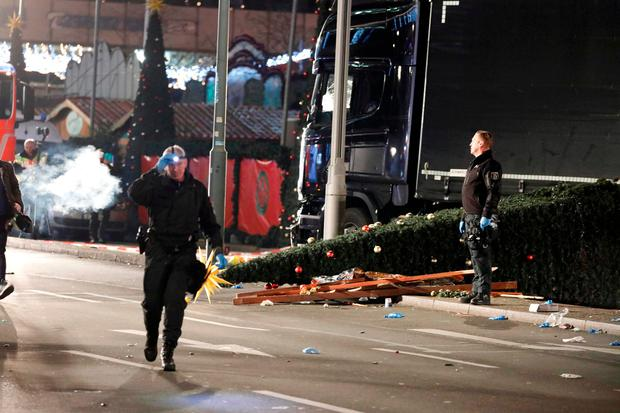 Police inspect the truck which ploughed into the crowded Christmas market in the German capital. REUTERS/Pawel Kopczynski