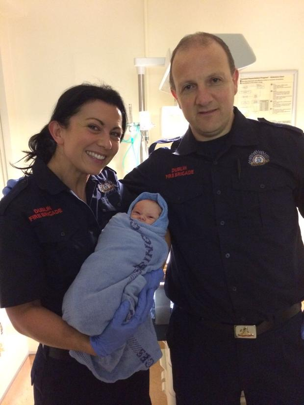 Firefighters Sarah and Niall with baby Aubrey